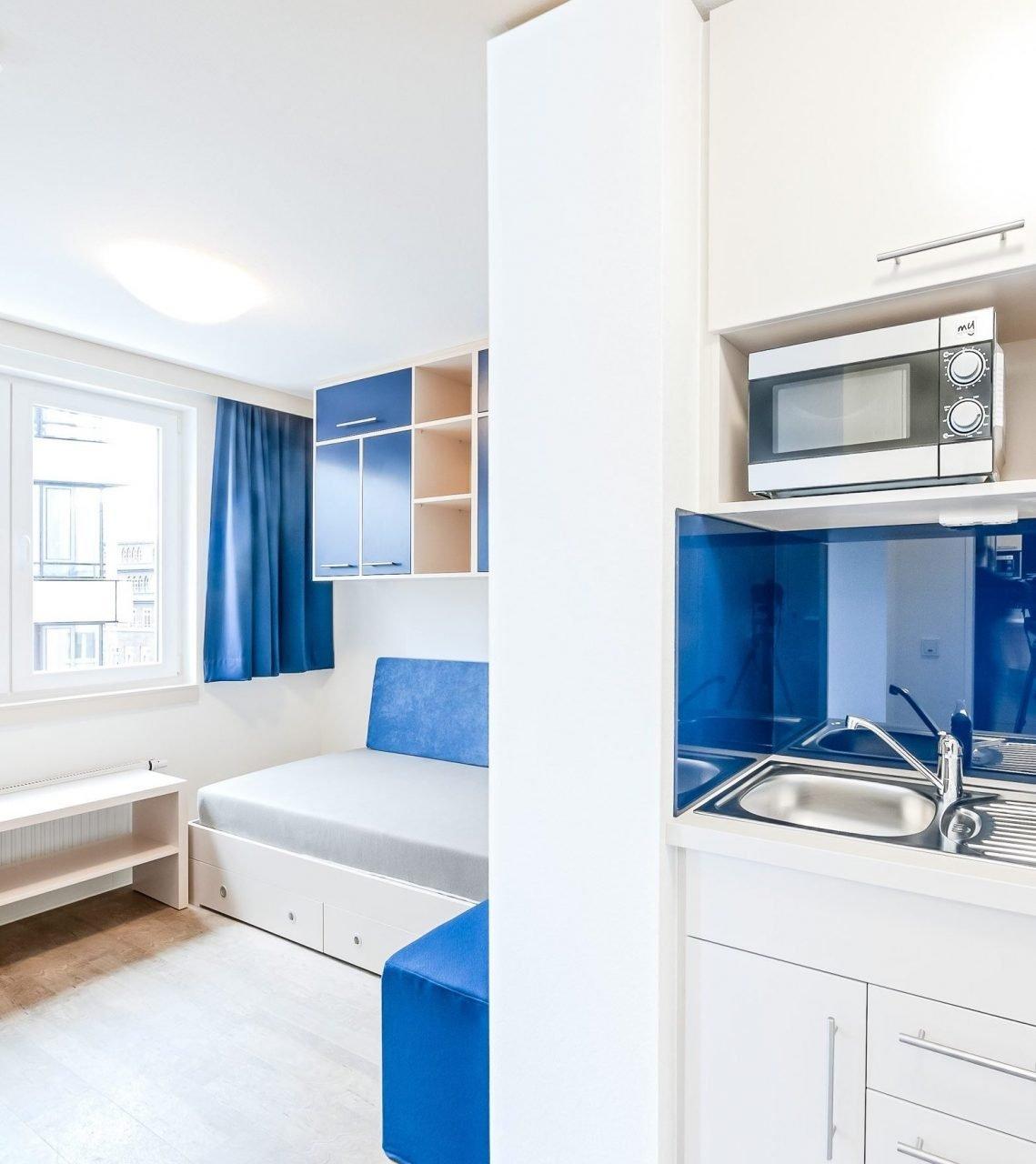 SMARTments Hamburg - Wohnraum mit Küchenzeile